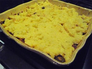 the corn meal mixture atop the beef tamale pie